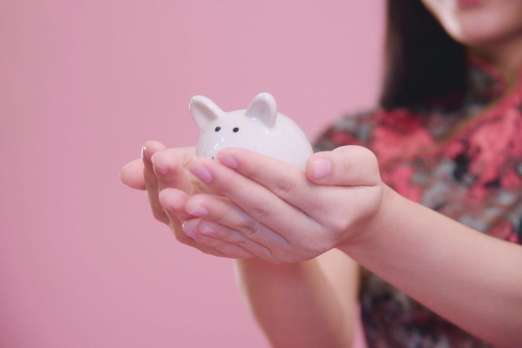 Little Piggy bank in hand.